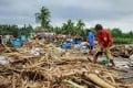 Residents of Sorsogon, south of Manila, gather debris following a typhoon. Photo: AFP