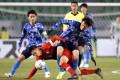 Japan's Koki Ogawa (right) gets into a tangle with Hong Kong captain Huang Yang during their EAFF Championship game. Photo: Reuters