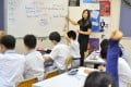 A teacher leads an English class using methods that encourage student participation, at a secondary school in Tai Po in May 2013. Photo: SCMP