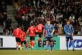 South Korea's Hwang In-Beom celebrates scoring with teammates as Japan's players walk away. Photo: Reuters