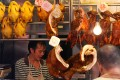 Li Bao Ge specialises in siu mei (roasted meats) like those seen here, hanging in a shop at Bowrington Road Market, Wan Chai, Hong Kong. Photo: Felix Wong