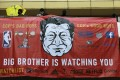 Protesters hang up a banner during a march in Hong Kong on October 20. Photo: Reuters