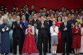 President Xi Jinping (centre), outgoing Macau leader Fernando Chui (second left) and incoming chief Ho Iat-seng (second right) join performers onstage during a show in the city. Photo: Reuters