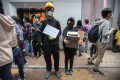 Protesters hold a box to collect Christmas cards for detained and jailed protesters on December 16. Photo: AP