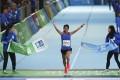 Christy Yiu kit-ching wins the women's half-marathon at the Standard Chartered Hong Kong Marathon. Photo: Nora Tam