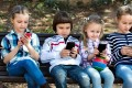 Want to give your child their first smartphone? Don't consider their age – think about if they are truly ready for one before you do. Photo: Shutterstock