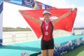 Poon O-yu celebrates with the Hong Kong flag after winning the women's junior singles sculls. Photo: HKRA