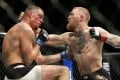 Conor McGregor (right) trades punches with Nate Diaz during UFC 196. Photo: AP