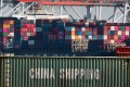 Shipping containers from China and other Asian countries are unloaded at the Port of Los Angeles in Long Beach, California on September 14. Photo: AFP