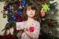 Tesco halted production of its charity Christmas cards after Florence Widdicombe, six, found a message apparently written by an inmate. Photo: AP