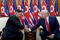 US President Donald Trump shakes hands with North Korean leader Kim Jong-un during a meeting in June 2019. Photo: Reuters
