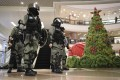 It is a pity that chaos and violence returned after a brief respite. The protests moved inside festive shopping malls. Santa Claus and revellers were replaced by black-clad protesters and police with riot gear. Photo: AP