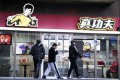 """The """"Bruce Lee"""" logo has been used by a Chinese fast food chain for 15 years. Photo: AFP/Noel Celis"""