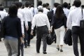 Morning commuters pictured in Tokyo, Japan. Photo: Bloomberg