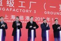 Elon Musk, chief executive officer of Tesla (Centre) with Robin Ren, vice-president of sales, second left, Ying Yong, mayor of Shanghai, second right, and Wu Qing, vice mayor of Shanghai, right, at an event at the company's manufacturing facility in Shanghai in January 2019. Photo: Bloomberg