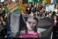 Demonstrators, many of them young students, hold up a banner featuring Swedish environmental activist Greta Thunberg, as they hold a rally on March 15 in central Rome, Italy, calling for action on climate change. Photo: AFP
