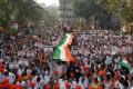 Supporters of India's ruling Bharatiya Janata Party (BJP) carry national flags during a rally in Mumbai in support of a new citizenship law. Photo: Reuters