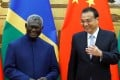 Solomon Islands Prime Minister Manasseh Sogavare and Chinese Premier Li Keqiang at an October signing ceremony at the Great Hall of the People in Beijing. Photo: Reuters