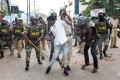 Police with sticks locally known as 'lathi' beat a protester during a demonstration against India's new citizenship law in Mangalore. Photo: AFP