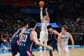 Jeremy Lin shoots the ball for the Beijing Ducks in the Chinese Basketball Association. Photo: Xinhua