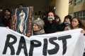 Activists take part in a protest outside the Famagusta courthouse in Paralimni, Cyprus after a British woman was found guilty of faking a rape claim. Photo: Reuters