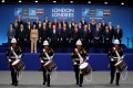 Nato heads of government watch a marching band perform as they pose for a group photo at the Nato summit at the Grove hotel in Watford, northeast of London, on December 4. Photo: AFP
