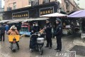 Law enforcement officers stand guard outside the seafood market in Wuhan that was ordered to close after a mystery flu outbreak. Photo: Yangtze Daily
