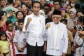 Indonesia's President Joko Widodo and Vice-President Ma'ruf Amin are seen after the announcement of the 2019 election results in Jakarta. Photo: EPA-EFE