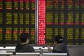 Investors monitor stock prices at a brokerage in Beijing on November 11. Photo: Associated Press