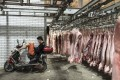 China's consumer price inflation (CPI) rose to a near eight-year high of 4.5 per cent in November, as pork prices doubled due to an outbreak of African swine fever. Photo: Bloomberg