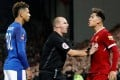 Referee Robert Madley has to separate Everton's Mason Holgate and Liverpool's Roberto during a FA Cup clash in 2018. Photo: Reuters
