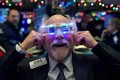 Trader Peter Tuchman wears 2020 glasses to celebrate the New Year at the New York Stock Exchange on Tuesday. Photo: Reuters