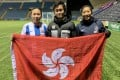 Kilmarnock Ladies players Vicky Chung (left) and Chun Ching-hang (right) visited by a Hong Kong fan at Rugby Park. Photo: Handout