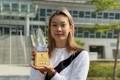 Stephanie Au displays her trophy at the Sports Institute. Photo: Chan Kin-wa