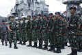 Vice Admiral Yudo Margono, front left, inspects Indonesian troops at Natuna military base. Photo: AFP