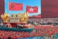 A float featuring the 'one country, two systems' policy passes Tiananmen Square during a National Day parade in Beijing. Photo: Reuters
