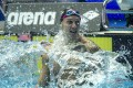Caeleb Dressel of the USA celebrates after winning the men's 100m butterfly gold at the 2019 world championships. Photo: EPA