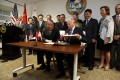 California's then governor Jerry Brown (seated right) and Xie Zhenhua, then vice-chairman of China's National Development and Reform Commission, sign an agreement to boost bilateral cooperation on climate change, at the Bay Area Council in San Francisco in September 2014. Photo: AP