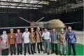 Officials attend weapons producer PT Dirgantara Indonesia's roll-out of a prototype of the MALE unmanned aerial vehicle, or UAV. Photo: Twitter
