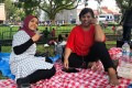 Indonesian domestic workers Sofia Marsudin, 49, and Sadiam Sadin, 47, enjoy a Sunday picnic. For many foreign workers in Singapore, it is difficult to find a safe and comfortable space to spend their day off. Photo: Kok Xinghui