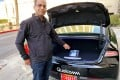 Dheeraj Ahuja, senior director of engineering at Qualcomm, points at the new Snapdragon Ride autonomous driving computing system in the trunk of a demo car at the 2020 CES in Las Vegas, US, January 5, 2020. Photo: Reuters