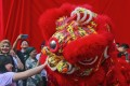 A lion dance performance during an event at a shopping centre for the upcoming Lunar New Year celebration in Kuala Lumpur. Photo: EPA-EFE