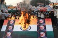Activists of the Youth Forum for Kashmir burn an Indian flag with pictures of Indian Prime Minister Narendra Modi on Human Rights Day. Photo: AFP