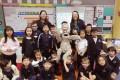 Author Jan Latta, Sleepy the Sloth and children at Concordia school in Shanghai, China. Photo: courtesy of Jan Latta