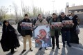 Iranians hold pictures of Qassem Soleimani during an anti-US protest in Tehran. Photo: EPA-EFE