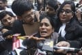 The mother of the victim of the fatal 2012 gang-rape on a New Delhi bus speaks to the media after a court scheduled the executions of the four men convicted of the crime. Photo: AP