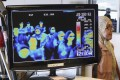 A thermal camera monitor shows the body temperature of international passengers arriving at the Incheon International Airport in South Korea. File photo: Yonhap via AP