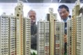 Potential buyers look at a scale model of Home Ownership Scheme flats in Lok Fu. Photo: Dickson Lee