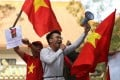 Anti-China protesters wave Vietnamese flags and shout slogans in front of the Chinese embassy in Hanoi. Photo: AFP