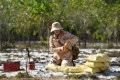 A deminer prepares to detonate unexploded ordnance at a site in Quang Tri province. Photo: AFP